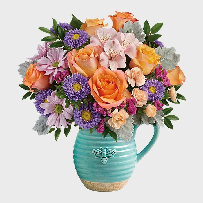 Teleflora Busy Bee Pitcher Bouquet
