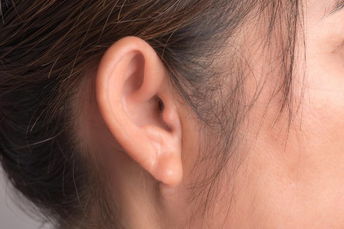 young woman ear close up