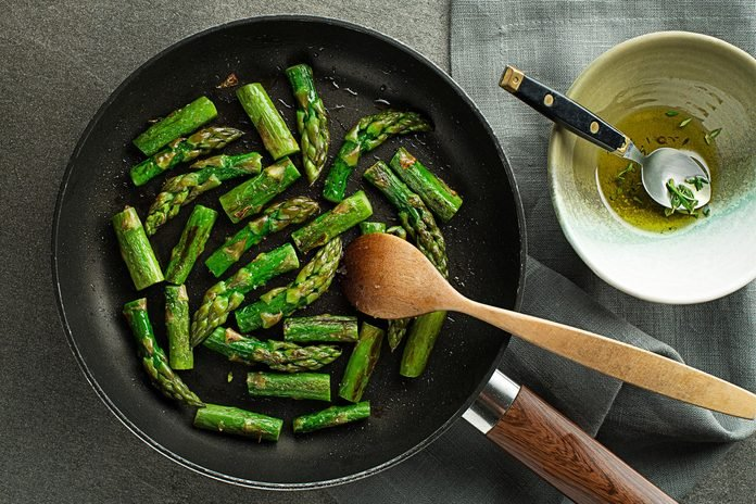 Fresh of green Asparagus. Cooking healthy meal in pan top view- Image