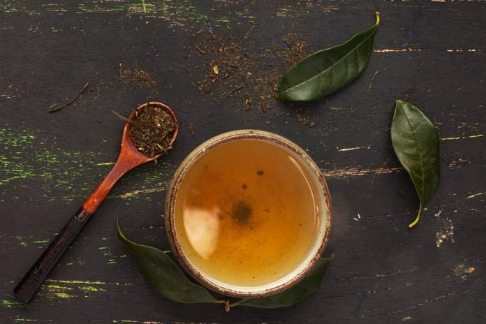 green tea in a bowl on a dark background