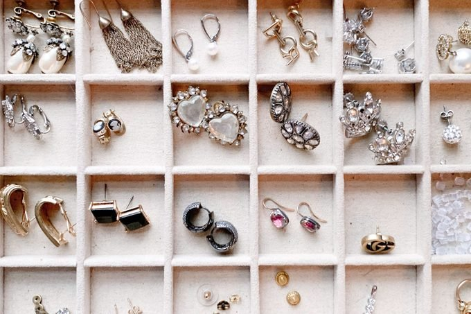 overhead view of jewelry and earrings organized into a section tray
