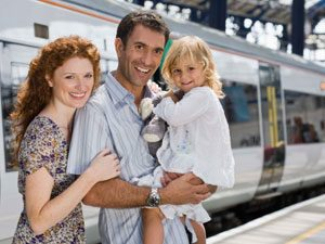 family beside train