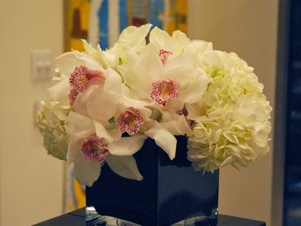White Pom, Cymbidium, and Freesia Arrangement