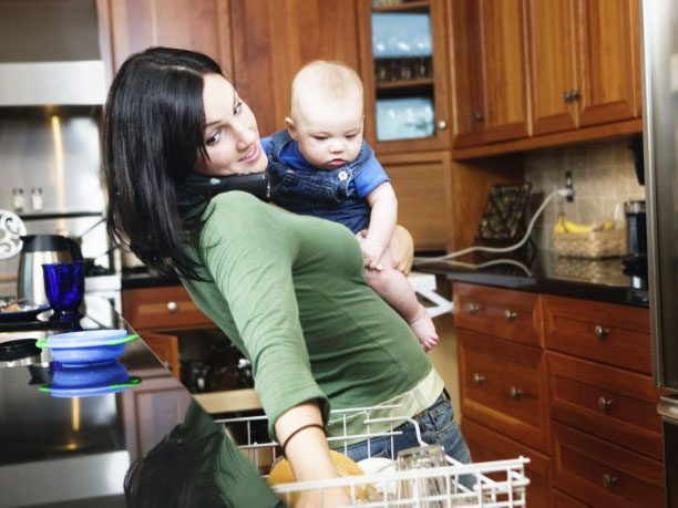 Woman with baby, cleaning