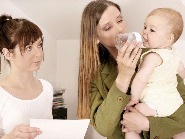 Working mom with nanny and baby