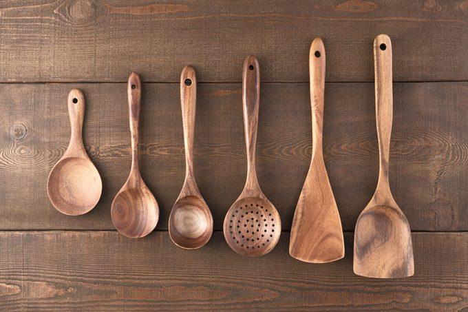 Wooden Kitchen Utensils on Wood Table