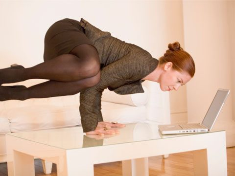 woman in pantyhose and business suit does yoga