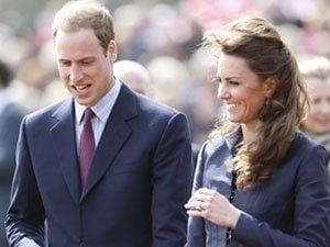 Britain's Prince William walks with his fiancee, Kate Middleton