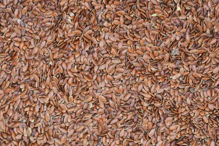 Flax seeds background. Linum usitatissimum, linseed, flaxseed. Close-up of flax grains