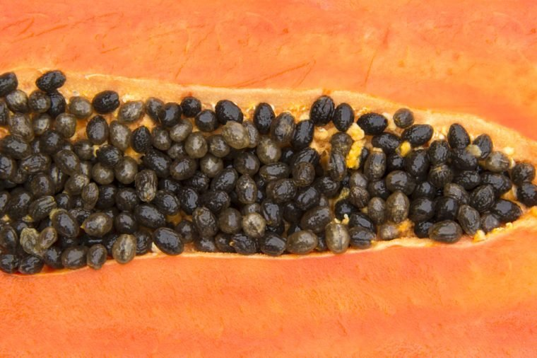 Background Close up Meat in half filled with seeds of Papaya sweet breed name holland.