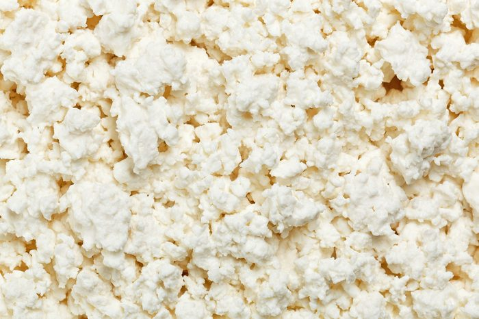 Cottage cheese (curd) top view, food background