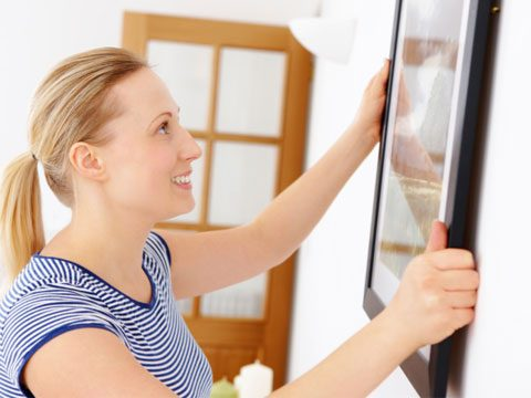 6. Hanging pictures flat against a wall, which can encourage mold growth.