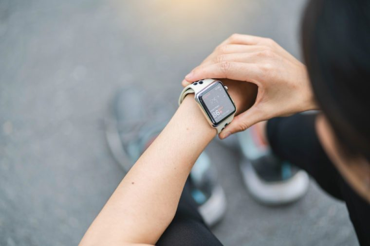 Woman check Heart rate app on Apple Watch After Working out