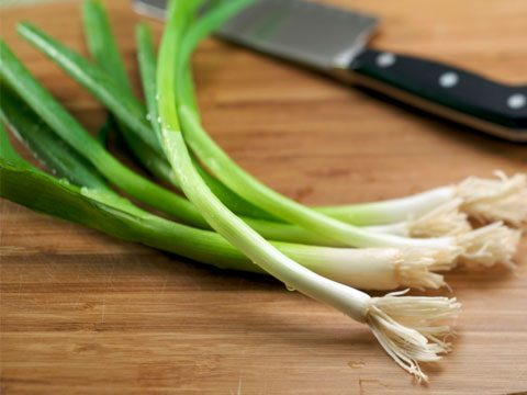 9. Sprinkle scallions over your salad.