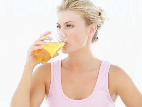 healing vinegar woman drinking juice
