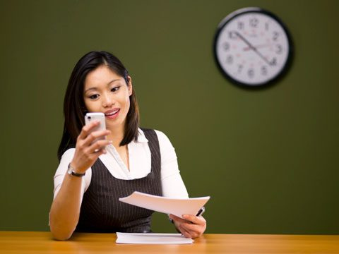 woman texting at work annoying technology