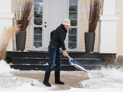 Sneak in Holiday Exercise woman shoveling