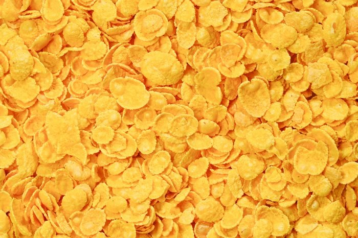 Corn-flakes background and texture. Top view. cornflake cereal box for morning breakfast.