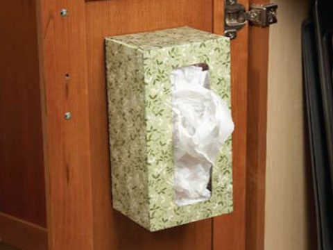 4. Use a tissue box to keep plastic bags organized.