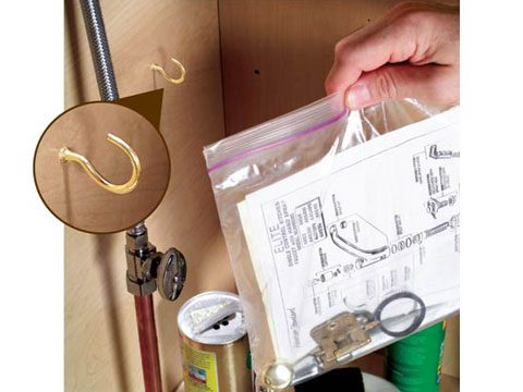 8. Use a zip-top bag to organize manuals under the sink.