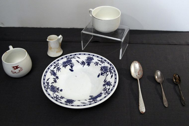 China and spoons from the RMS Titanic Inc. are on display at Guernsey's Auctioneers & Brokers, in New York. The auction of more than 5,000 Titanic artifacts a century after the luxury liner's sinking has stirred hundreds of interested calls, with some offering to add to the dazzling trove already plucked from the ocean floor