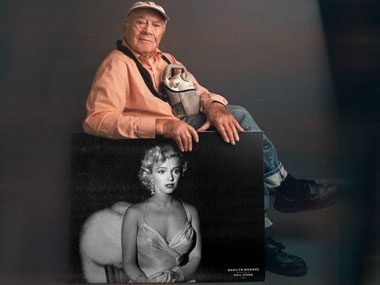 Photographer Phil Stern with his photo of Marilyn Monroe