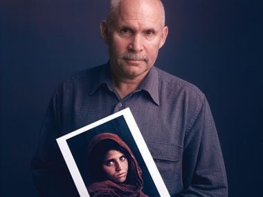 Photographer Steve McCurry with his photo of Sharbat Gula