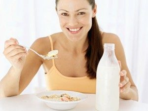 Woman eating bowl of cereal