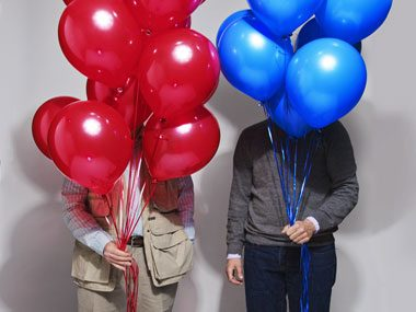 red dad, blue son Jerry and Joe Hagan with balloons