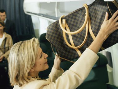 Can you: Load your luggage into the storage bin above your airplane or train seat without strain?