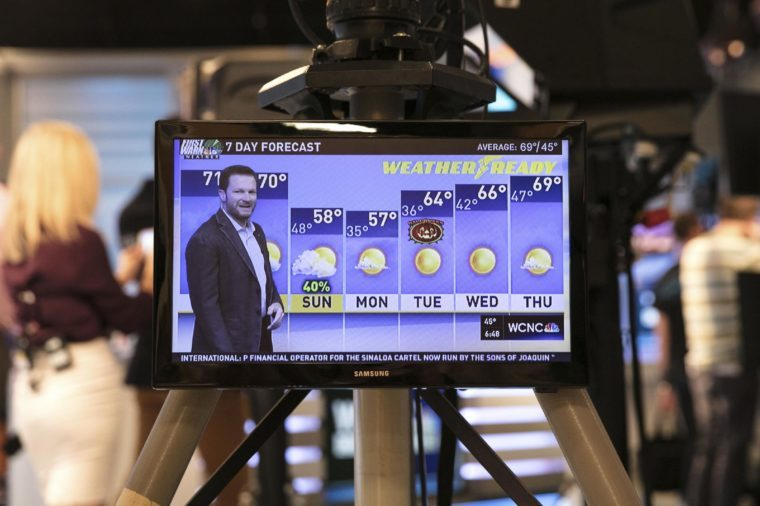 Dale Earnhardt Jr. delivers a surprise seven-day forecast at a Charlotte news station ahead of weekend NASCAR race in Martinsville to help launch Goodyear's new WeatherReady tire, in Charlotte, N.C