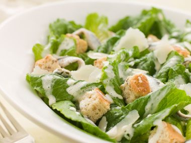 11. How do you mellow Caesar salad dressing?
