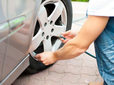 While at the filling station, inflate your tires properly and check them for uneven wear.