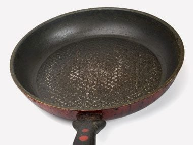 Worn plates, pots, and other cookware