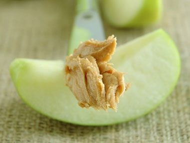 2. Eat a filling snack before the party, like an apple and two teaspoons of fiber-rich, protein-rich peanut butter.