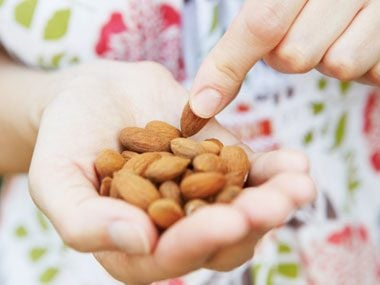 3. Pack a handful of almonds or a mini string cheese in your purse.