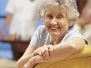 senior woman smiling on couch