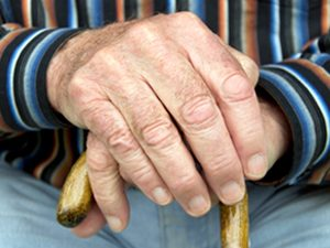 hands of senior with cane