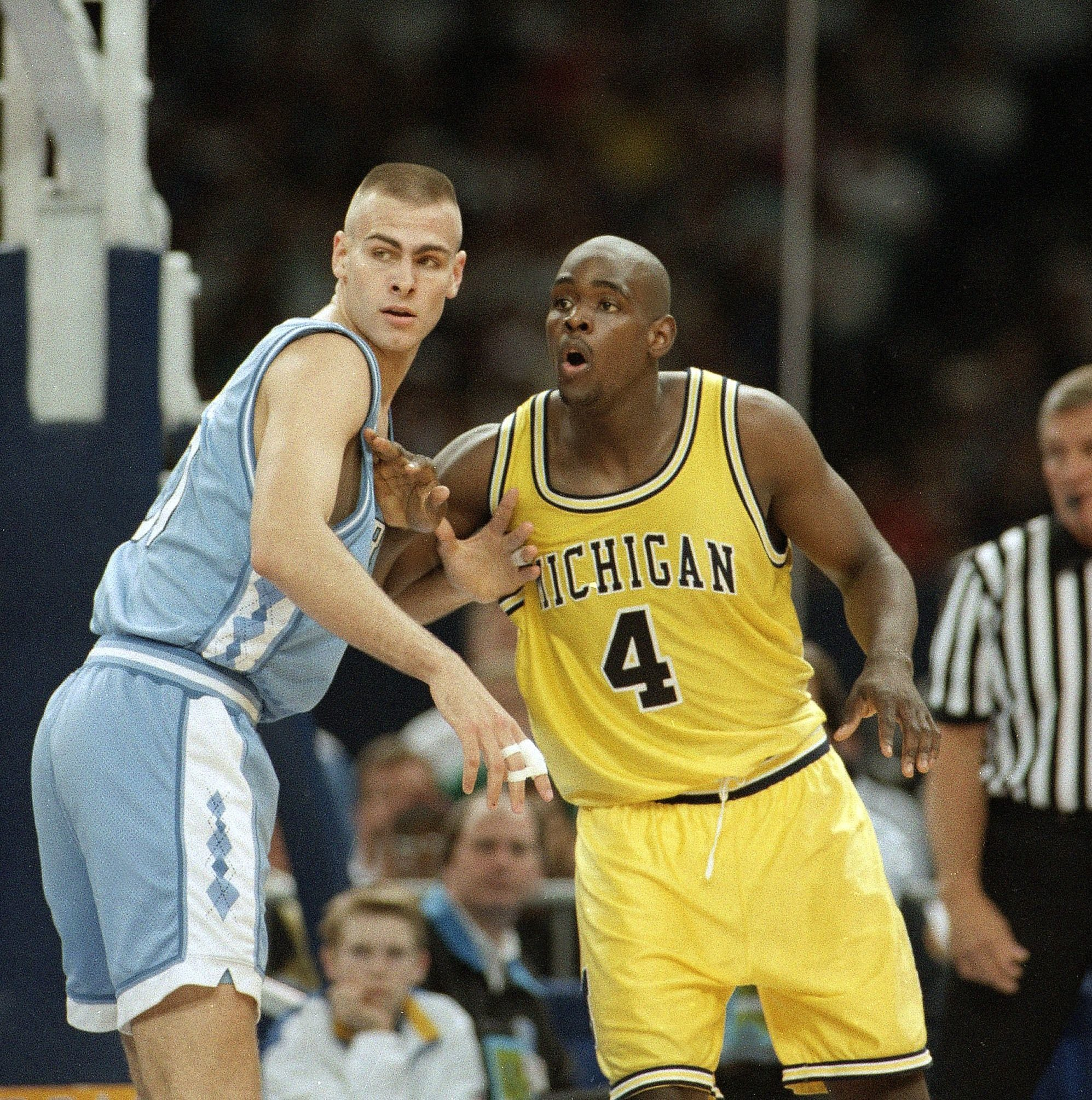 Mandatory Credit: Photo by David Longstreath/AP/Shutterstock (6566326a) Montross Webber North Carolina's Eric Montross, left, guards Michigan's Chris Webber during their Final Four championship game at the Superdome in New Orleans NCAA MONTROSS WEBBER 1993, NEW ORLEANS, USA