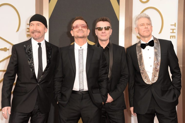 (L-R) Musicians The Edge, Bono, Larry Mullen Jr. and Adam Clayton of U2 attend the Oscars March 2, 2014
