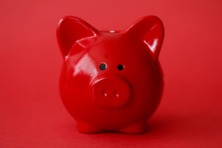 red piggy bank on red background