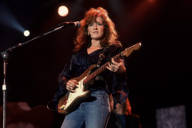 Bonnie Raitt performs at Farm Aid in the Hoosier Dome, Indianapolis, Indiana, April 7, 1990