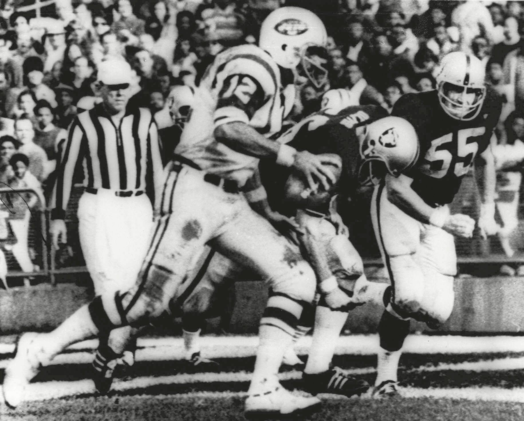 "Mandatory Credit: Photo by Uncredited/AP/Shutterstock (10479900a) HEIDI. New York Jets' quarterback Joe Namath (12) sweeps around the right side past Oakland Raider defenders Ralph Oliver (56) and Dan Conners (55) to score from the one-yard line during the second quarter of a football game at Oakland Coliseum in Oakland, Calif. The Jets were leading 32-29 when the childrens classic ""Heidi"" began on NBC, interrupting the final minutes of the game which the Raiders won 43-32 in one of the most dramatic rallies in AFL history Game of the Week Analysis Football, OAKLAND, USA - 17 Nov 1968"