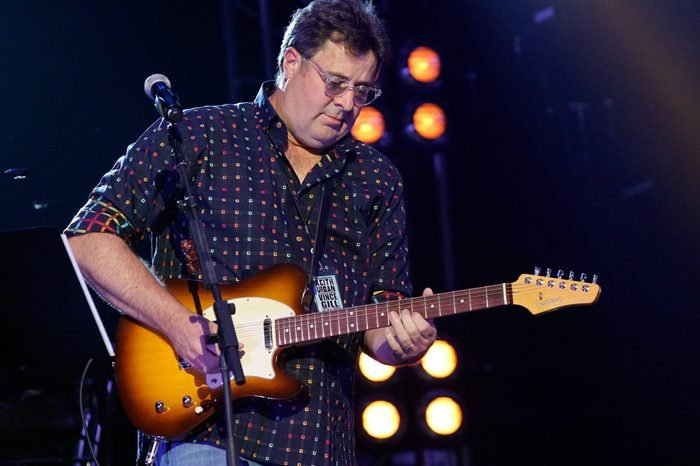 """Vince Gill performs on stage during Keith Urban's Fifth Annual """"We're All 4 The Hall"""" Benefit Concert at the Bridgestone Arena on May 6, 2014 in Nashville, Tennessee."""