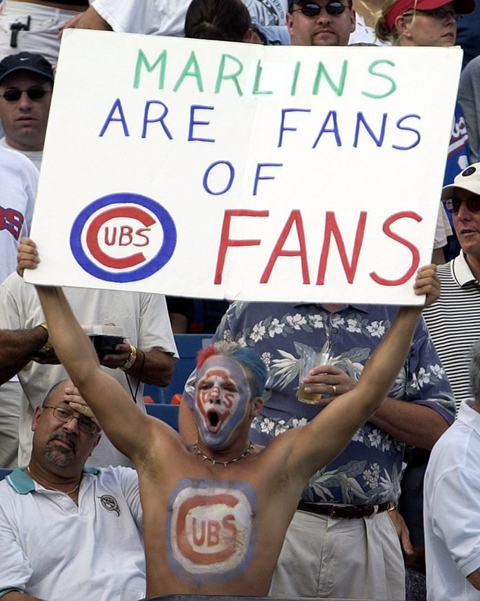 Mandatory Credit: Photo by Rhona Wise/EPA/Shutterstock (7912107a) A Chicago Cubs Fan Shows His Feelings with a Sign and Body Paint During Game Five of the National League Championship Series Against the Florida Marlins Sunday 12 October 2003 at Pro Player Stadium in Miami Florida Usa Baseball Cubs Marlins Fan Support - Oct 2003