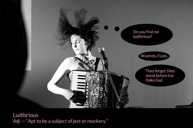 Crazy girl with accordion looking ludibrious