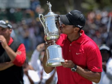 Tiger Woods with trophy