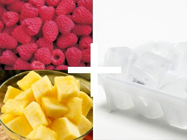 Raspberries and pineapple chunks ice cubes
