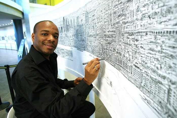 Artist Stephen Wiltshire sketching a panorama of London from memory