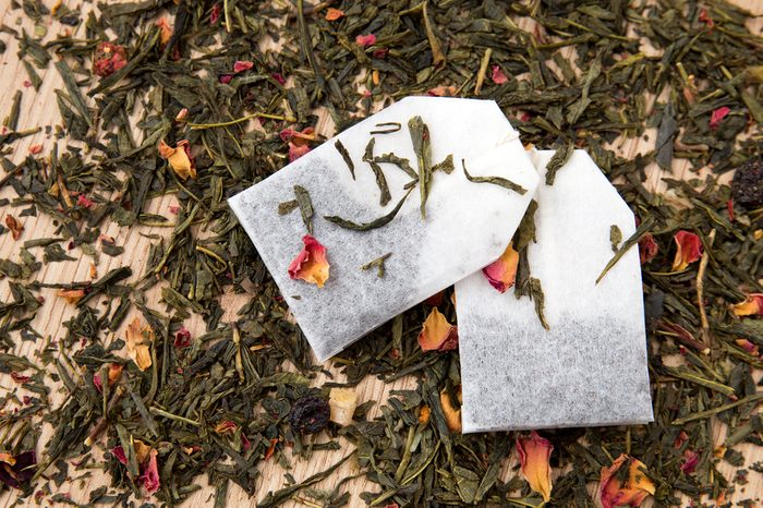tea bags with scattered green tea